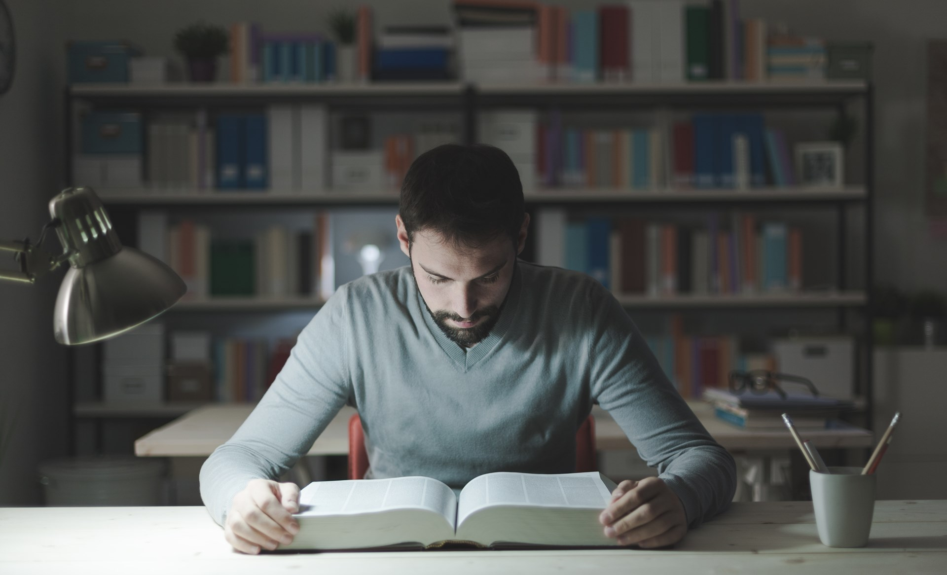 Image result for man reading a book in the study room
